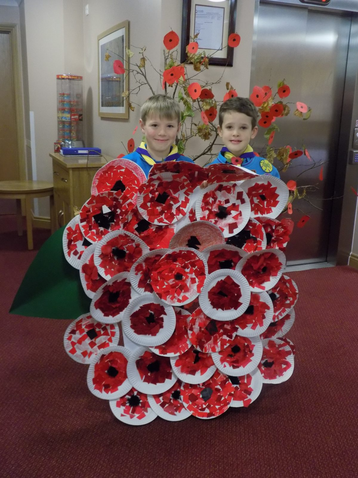 Beavers – donating a poppy to Orchid Residents